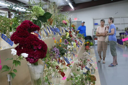 Floral arrangements sit on display at the 2019 Baxter County Fair.