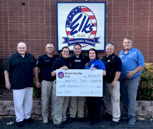 The Mountain Home Elks lodge No.1714 recently donated $900 to the Mountain Home Police Department School Resource Officer Program. School Resource Officers are responsible for providing students a safe learning environment and promoting positive relations between youth and law enforcement. Pictured are: (from left) Stuart Friend, Elks president; Sgt. Eddie Helmert; Officer Danielle Campfield; Officer Zack Ables; Officer Lacy Holland', Sgt. Bubba Jones; and Chris Robinson, Elks Benevolence chairman.