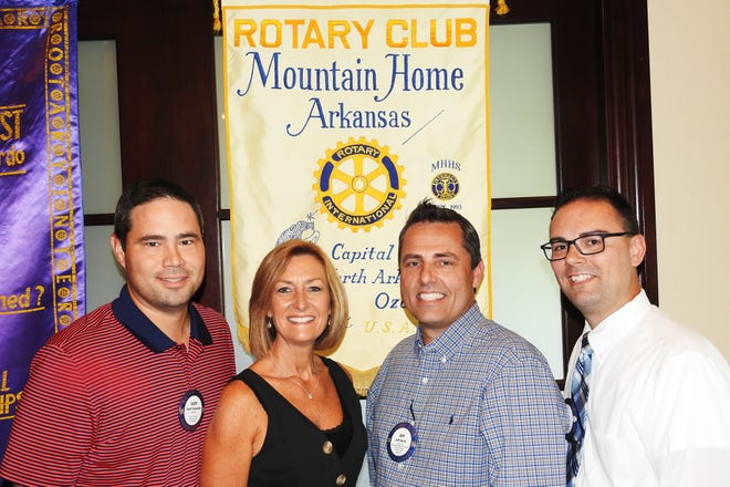 """The Rotary Club of Mountain Home has partnered with the Food Bank of North Central Arkansas every year in support of """"Bridge Bash.""""The Director of the FBNCA is Rotarian Jeff Quick, who is joined on the Board by fellow Rotarians Susan Stockton, Scott Copeland, Jewel Pendergrass, Tom Kiley, Randy Ludwig, Renae Schocke and Glen Dimick. Pictured are: (from left) Copeland, Stockton, Quick and Kiley.Local Rotarians will be helping fill meal packs this Saturday, September 21, at """"Bridge Bash"""" on the campus of ASUMH."""