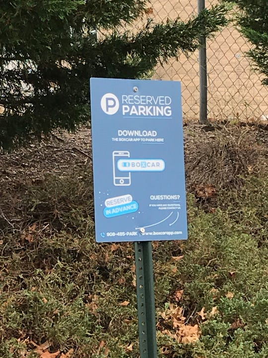 Boxcar signs located at available parking spots