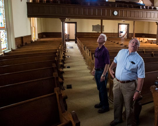 Architect Richard Hudgens, left, and structural engineer Marc Barter examine the chapel at the former First Presbyterian Church in Montgomery, Ala., on Friday, Sept. 13, 2019.
