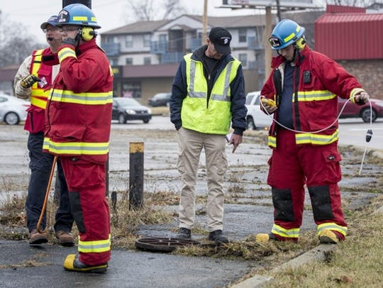 Emergency responders, including haz-mat personnel, investigated a report of gasoline being dumped into the city's sewer system at a Wheeling Avenue convenience store on Jan. 16, 2017.