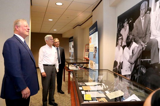 Former U.S. Vice President Al Gore, left, Bart Gordon, a former congressman, center, and MTSU Provost Mark Byrnes all view the recent exhibit about Al Gore Sr.'s political career at the MTSU James E. Walker Library on Monday.