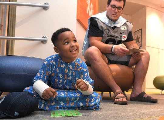 Vanderbilt football player Drew Birchmeier plays bingo with patient Jayce Lockett, 6, at a Turner's Heroes event Thursday at Monroe Carell Jr. Children's Hospital at Vanderbilt.
