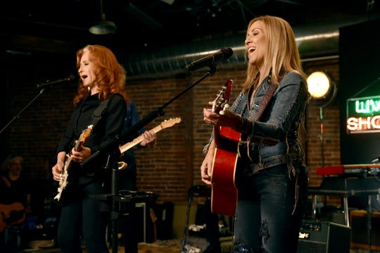 Bonnie Raitt and Sheryl Crow perform onstage during a special event hosted by Spotify and AmericanaFest at Cannery Ballroom on September 10, 2019 in Nashville, Tennessee.