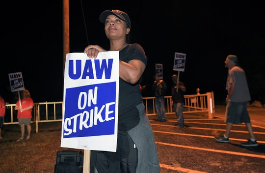 General Motors worker Lynetta Quinn strikes with other coworkers outside a gates at the GM plant in Spring Hill, Tenn. at midnight on Monday, Sept. 16, 2019.