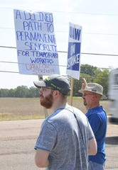 GM worker Jonathan Anderson strikes outside the GM plant in Spring Hill on Monday, Sept. 16.