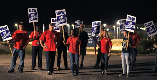 General Motors workers strike outside one the gates to the GM plant in Spring Hill, Tenn. at midnight on Monday, Sept. 16, 2019.