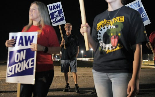 General Motors workers strike outside the GM plant in Spring Hill, Tenn. at midnight on Monday, Sept. 16, 2019.