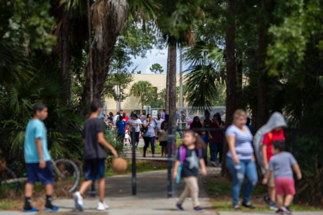 Students and parents walk home after school at Parkside Elementary School in Naples on Friday, September 13, 2019. Hector Manley, a former Parkside Elementary School teacher, has been accused of 19 counts of lewd and lascivious molestation and two counts of capital sexual battery against someone younger than 12. Children told investigators that Manley touched them inappropriately at school and at soccer practice, where he was a coach for a local team.