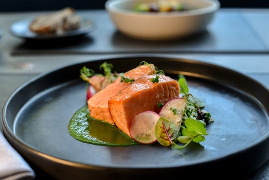 An homage to nouvelle cuisine: salmon & sorrel with wild rice and radishes at Faubourg in Montclair