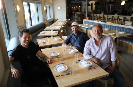 Consulting chef and partner Paul Gerard (left), owner Russell Stern (right foreground) and executive chef Pasquale Frola at the soon-to-open Stern & Bow, Closter.