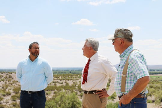 From left: Commissioner Manny Sanchez, Doña Ana County District 5, Doña Ana County Manager Fernando Macias; neighborhood resident Joe Delk survey the Alvillar Dam area and discuss potential solutions.