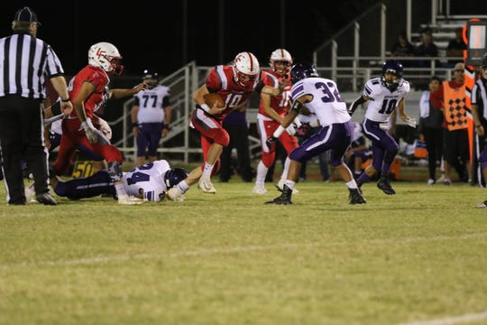 Loving Falcon Dylan Green breaks away from Mescalero Chief defense to score in the third quarter of the Falcon's Homecoming game on Sept. 13. In the last two games Green has scored five rushing touchdowns for Loving.
