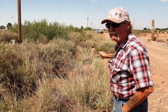 "Stephen ""Pete"" Hawks surveys Mariposa Lane off Riata Road."