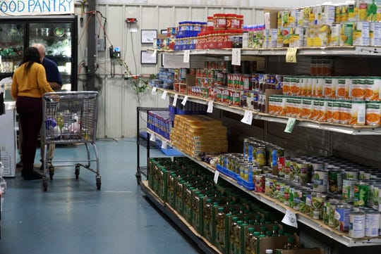 Bazzy's Zaman International charity in Inkster has shelves of donated food from Gleaners and other groups that their clients can get a reduced prices - or for free.