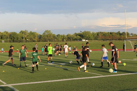 The South Lyon East boys soccer team organized a youth camp as a way to give back to the community.