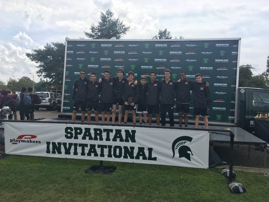 The Northville boys cross country team finishes in third place at the Michigan State Spartan Invitational in East Lansing.