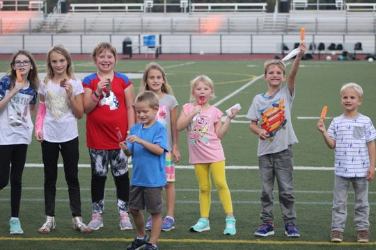 Participants in the South Lyon East soccer camp enjoy their treats at the end of the camp.