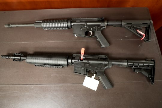 A real AR-15 (top) sits in comparison to a replica (below) confiscated from Desert Hot Springs students in Desert Hot Springs, Calif. on Monday, September 16, 2019.