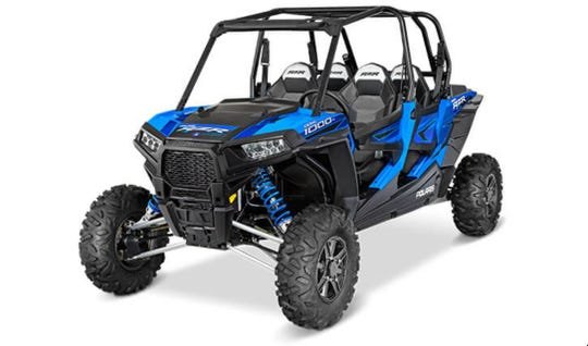 A girl was driving a 2015 Polaris RZR similar to this one with three passengers aboard when she tried to turn left, causing the vehicle to roll onto its right side and crushing two boys.