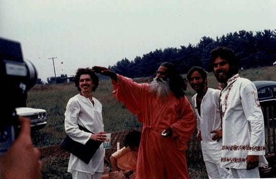 Swami Satchidananda arrives at Woodstock. Sridhar Silberfein pictured third from left.