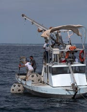 Eternal Reefs sinks 12 artificial reefs off Santa Rosa Island in the Gulf of Mexico on Monday.