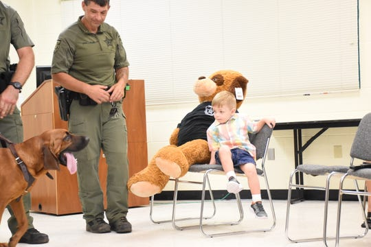 Three-year-old Aedric Arnold, who went missing Sunday, reunites Monday with Zinc, one of the Santa Rosa County Sheriff's Office K-9s who helped track him down.