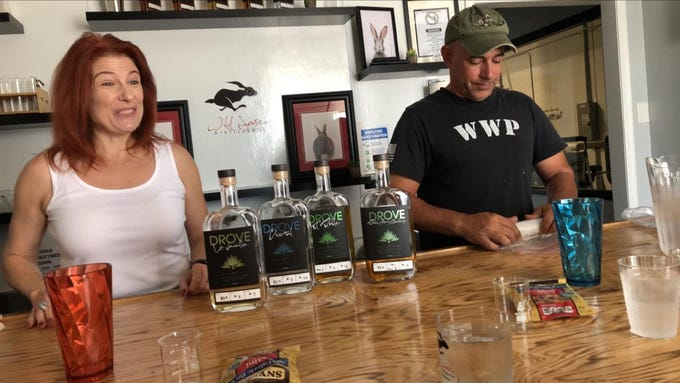 Wild Hare Distillery owners Wendy Tilton and Jim Matz serve customers at their Tempe tasting room and distillery.