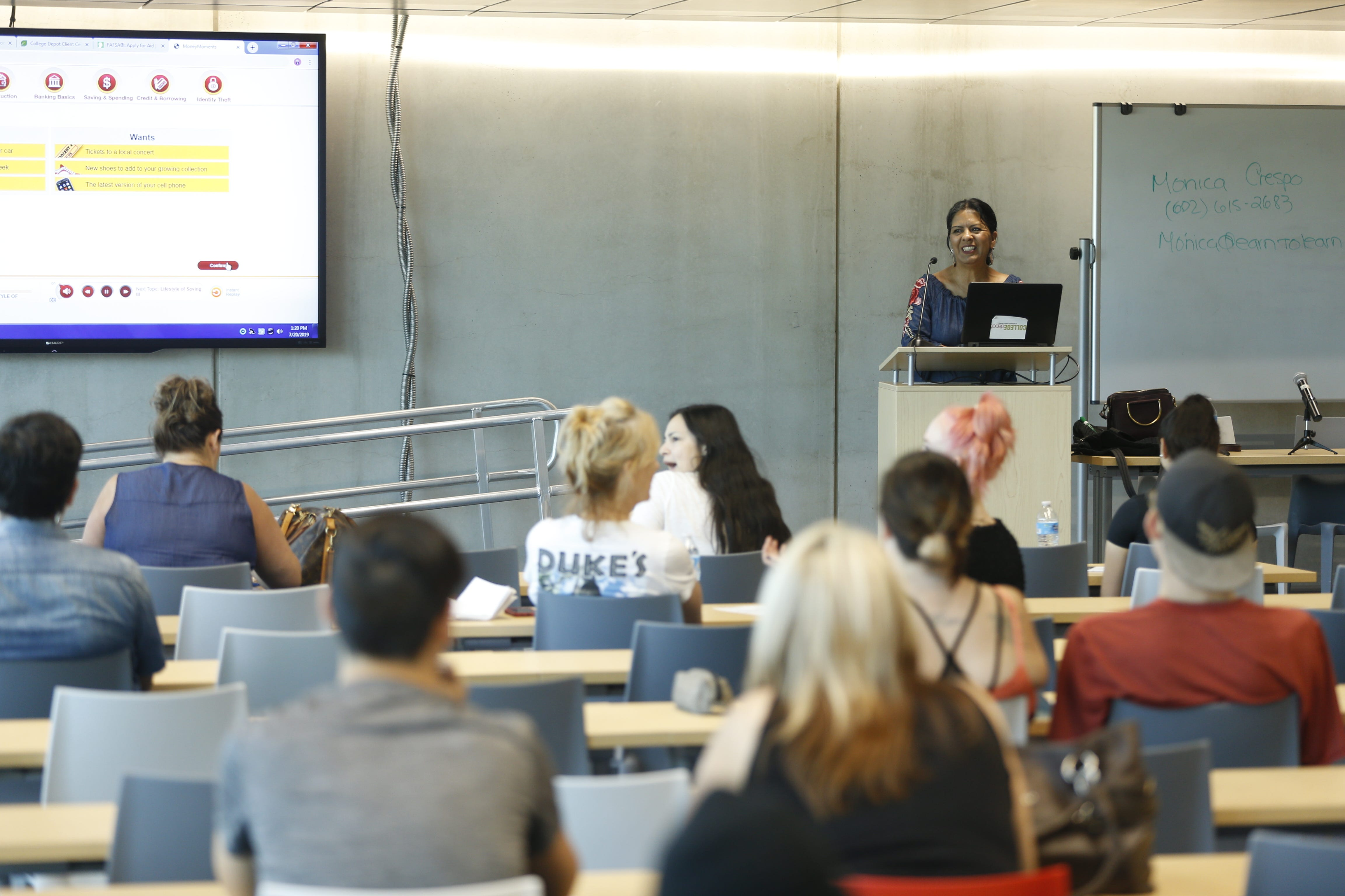 Students and parents attend a lecture helping with understanding the financial side of college during a College Depot event at the Burton Barr Phoenix Public Library in Phoenix on July 20, 2019.