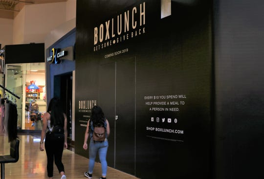 The BoxLunch store at the Arizona Mills mall in Tempe, still barricaded on Friday, Sept. 13 in preparation for its opening.
