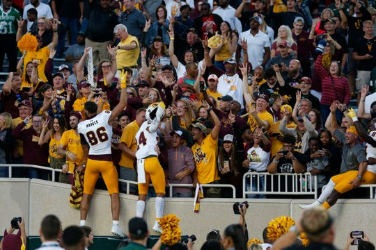 Arizona State players celebrate with fans following an NCAA college football game against Michigan State, Saturday, Sept. 14, 2019, in East Lansing, Mich.
