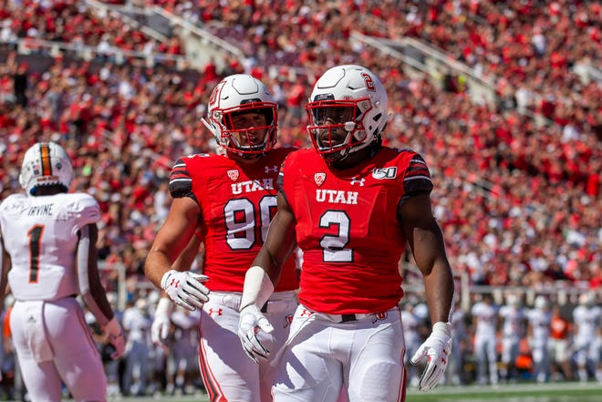 Zack Moss (2) ran for 106 yards in a 31-0 Utah win over Idaho State.