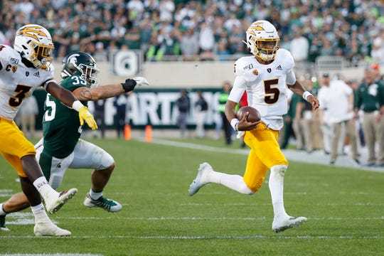 Jayden Daniels #5 of the Arizona State Sun Devils scrambles for a first down in the fourth quarter of the game against the Michigan State Spartans at Spartan Stadium on September 14, 2019 in East Lansing, Michigan. Arizona State defeated Michigan State 10-7.