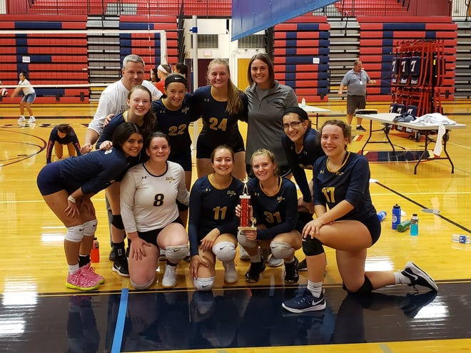 The Elco girls volleyball team was all smiles on Saturday after capturing the championship of the Cedar Classic at Lebanon High. The Raiders did not drop a set in the tournament and defeated Reading in the championship match.