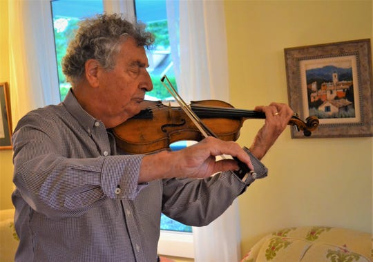 Max Rabinovitsj plays the violin at his Lakeside cottage.  Rabinovitsj will perform at Firelands Presbyterian Church as part of the Trio da Vinci on Sept. 22. The trio also includes Paul York on cello and Michael Chertock on piano.