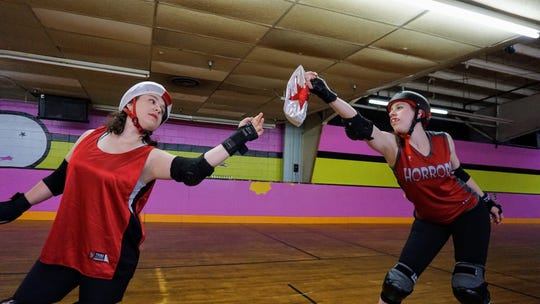 Paige Banfield, aka, Bruisin' B Anthony, left, and Gabrielle Gillett, aka Brass Canuckles, on the rink as their Hudson Valley Horrors roller derby alter egos.