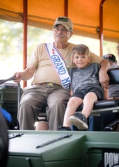 Frank Castella Sr. and a young passenger are shown aboard the Warrior Wagon.