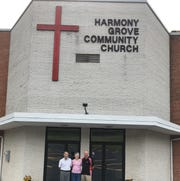 Ron Bupp, Sharon Mindemann and Pastor Jim Crosley in front of the Harmony Grove Community Church sanctuary.