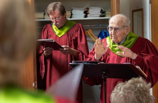 Clair Good leads the Chancel Choir during a warm-up before worship at Saint Paul United Methodist Church in East Manchester Township. Good, who turns 99 in October, began leading the choir in 1936.