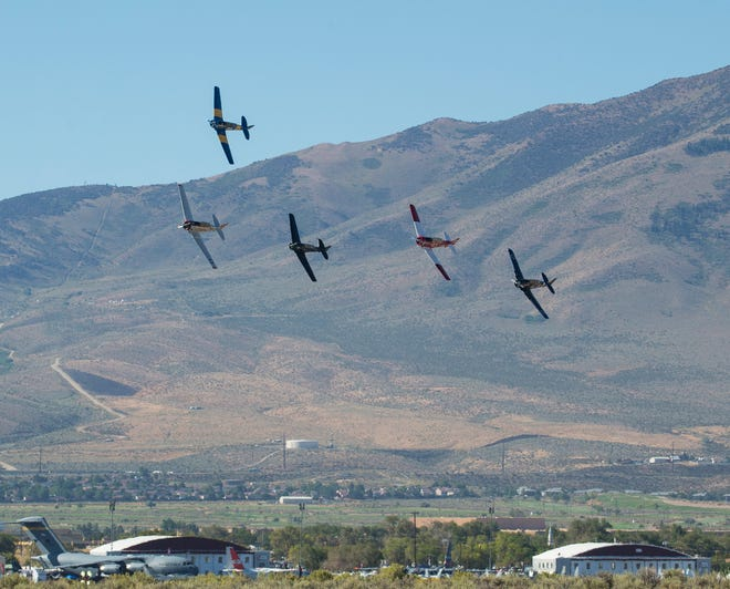 The start of a T-6 heat race is shown during the 2019 during the National Championship Air Races at Reno Stead Airport.