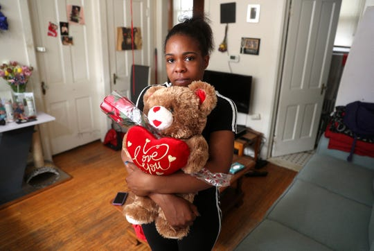 Tenitia Cullum snuggles one of her favorite stuffed animals she received after her 3-year-old son Bryce Raynor died.