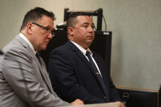 Clark Zimmermann stands beside Michael Sippel, former Rochester police officer found guilty of third-degree assault, a misdemeanor during sentencing in city court.  Sippel received  three years probation from  Rochester City Court Judge Thomas Rainbow Morse.