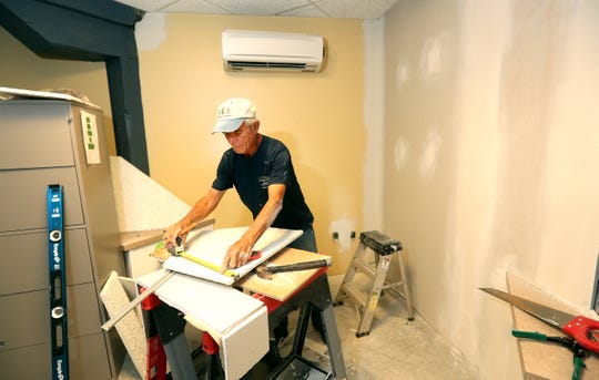 Construction worker Joe Stinardo adding walls and ceilings inside Bivona Child Advocacy Center that will create more office space for its employees.