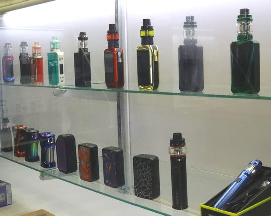 Vaping products displayed on a shelf at Discount Vapes on Churn Creek Road in Redding.