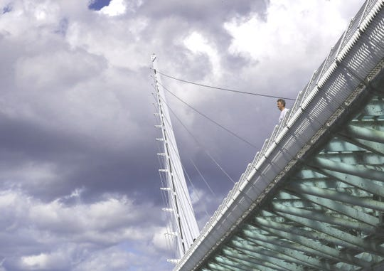 Kristoff Valk of the city of Leiden in the Netherlands peers over the Sundial Bridge on Monday, Sept. 16, 2019, against a backdrop of rain clouds. Rain that fell early Monday wasn't enough to dampen the wildfire risk in the North State, fire officials say.