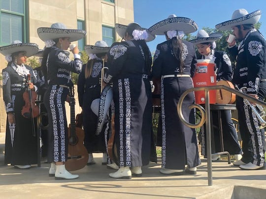 The Lake View Mariachi cools off after playing music at City Hall for Diez y Seis de Septiembre.