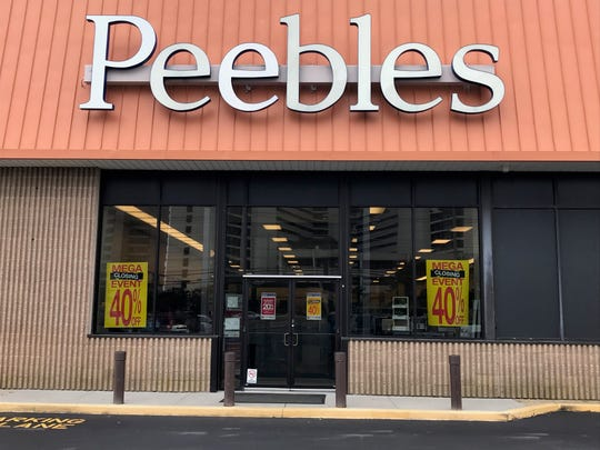 Signs posted at the storefront of Peebles at 11561 Coastal Highway show that the store will soon close.