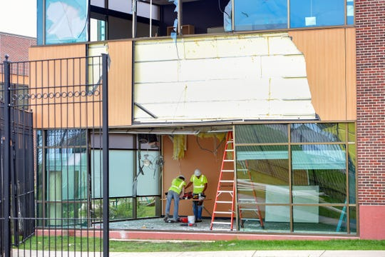 Construction workers from a national company work to rebuild the destroyed portions of the Avera Behavioral Health Center on Monday, September 16, in Sioux Falls.