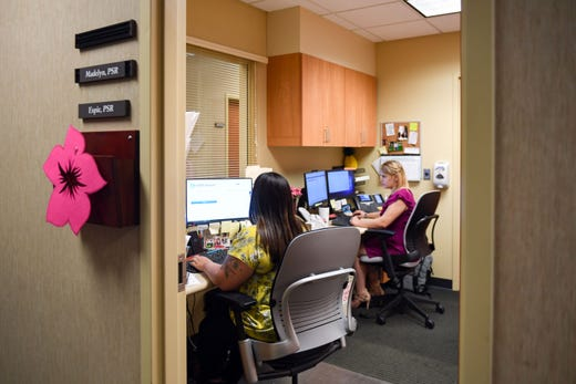 Espies Ortega and Madelyn Carrizales man the reception desk at the Avera Behavioral Health Center on Monday, September 16, in Sioux Falls.